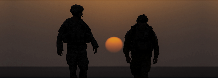 Image of silhouette of two soldiers
